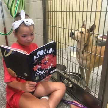 project apollo - child reading to dog 3